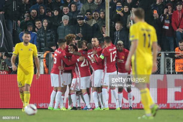 Players of Manchester United celebrate a goal of Henrikh Mkhitaryan during the UEFA Europa League Round of 16 first leg match between FC Rostov and...