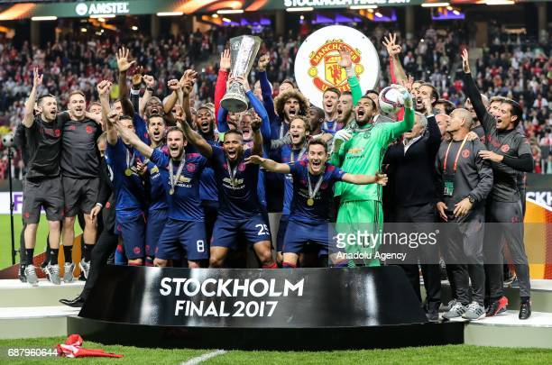 Players of Manchester United celebrate with trophy at the end of the UEFA Europa League Final match between Ajax and Manchester United at Friends...