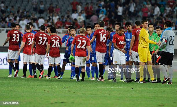 Players of Manchester United shake hands with players of Shanghai Shenhua after the Friendly Match between Shanghai Shenhua and Manchester United at...