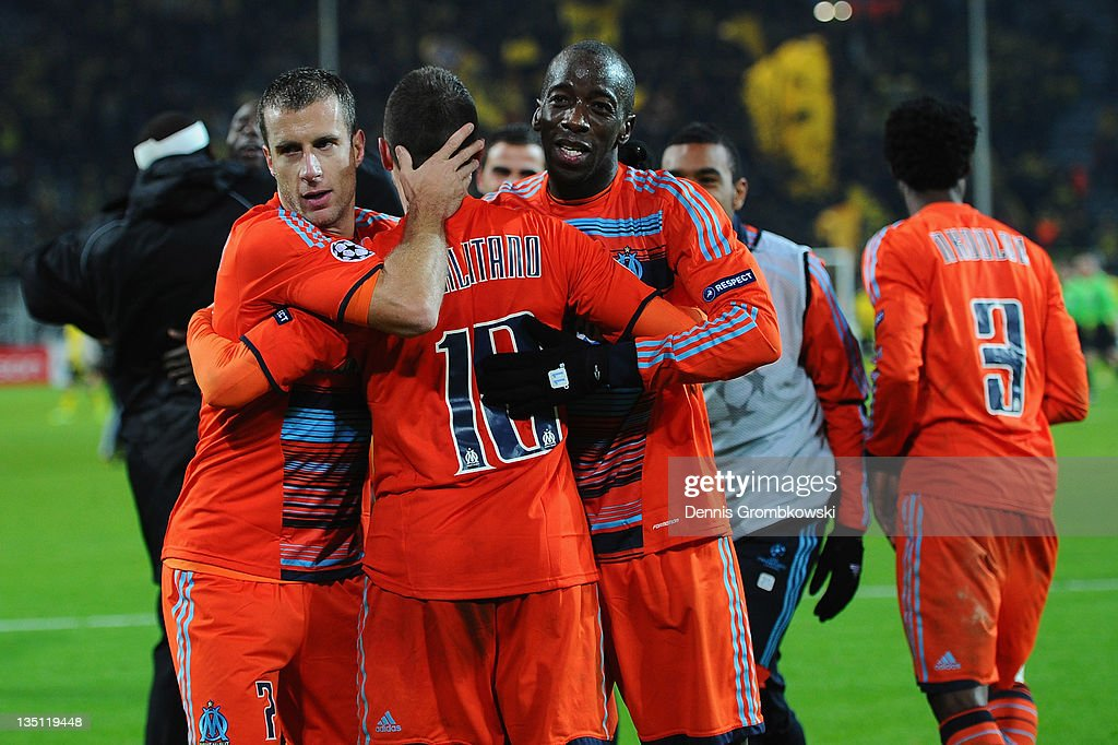 Players of Marseille celebrate after the UEFA Champions League group F match between Borussia Dortmund and Olympique de Marseille at Signal Iduna Park on December 6, 2011 in Dortmund, Germany.