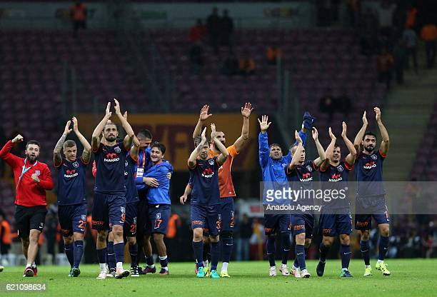 Players of Medipol Basaksehir greet supporters after winning the Turkish Spor Toto Super League soccer match between Galatasaray SK and Medipol...