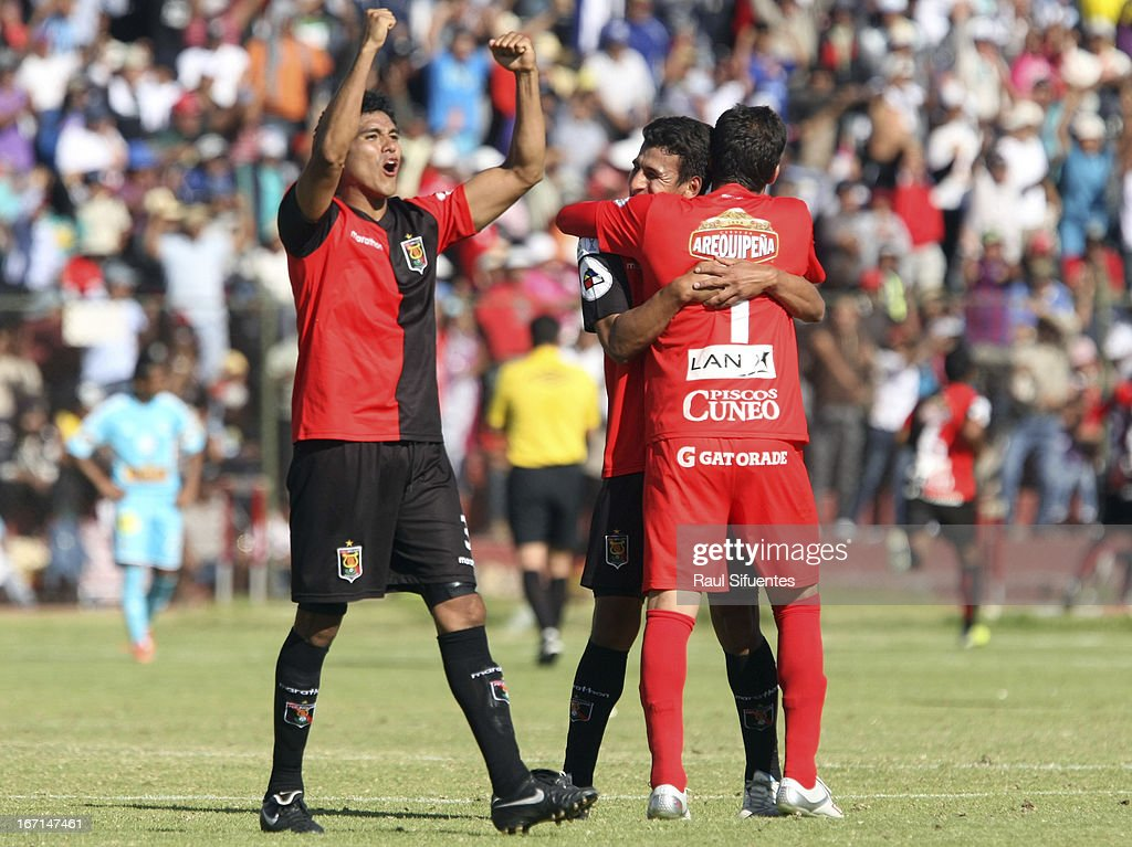 Players of Melgar FC celebrate a goal against Sporting Cristal during a match between Sporting Cristal and Melgar FC as part of the Torneo Descentralizado 2013 at the Mariano Melgar Stadium on April 21, 2013 in Arequipa, Peru.