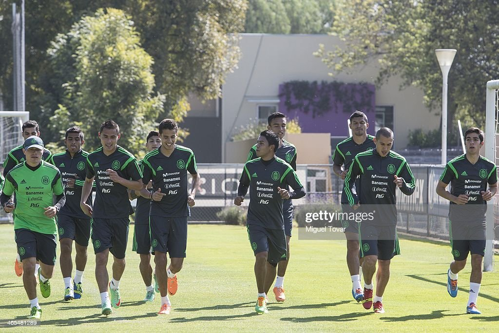 Players of Mexican National soccer team warm up during a training session at CAR on January 27, 2014 in Mexico City, Mexico. The team is preparing to face Korea in a friendly match before the FIFA World Cup in Brazil.