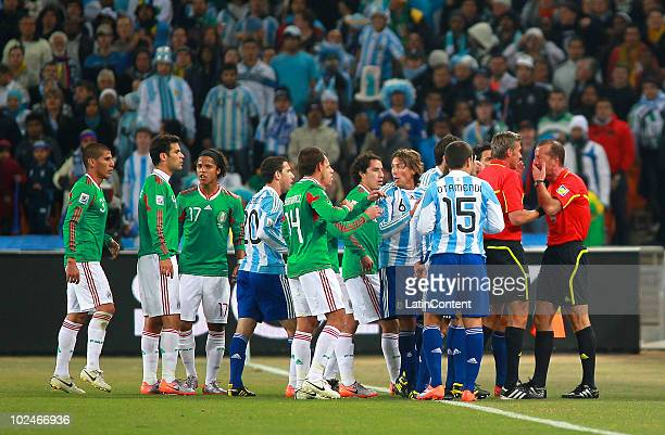 Players of Mexico and Argentina complain with the referee Roberto Rosetti and referee assistant Stefano Ayrold during the 2010 FIFA World Cup soccer...