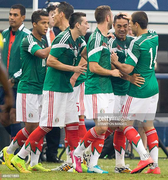 Players of Mexico celebrate a goal scored by Marco Fabian during the International Friendly match between Mexico and Ecuador at ATT Stadium on May 31...
