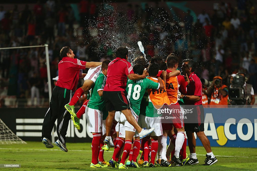 Players of Mexico celebrate after the FIFA U-17 World Cup UAE 2013 Quarter Final match between Brazil and Mexico at Al Rashid Stadium on November 1, 2013 in Dubai, United Arab Emirates.