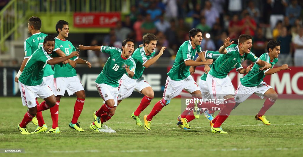 Players of Mexico celebrate after winning the penalty shootout of the FIFA U-17 World Cup UAE 2013 Quarter Final match between Brazil and Mexico at Al Rashid Stadium on November 1, 2013 in Dubai, United Arab Emirates.