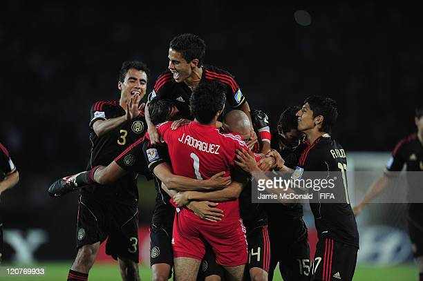 Players of Mexico celebrate beating Cameroon during the FIFA U20 World Cup Round of 16 match between Cameroon and Mexico at the Estadio Hernan...