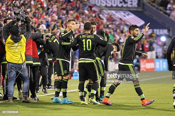 Players of Mexico celebrate their first goal during the match between USA and Mexico as part of FIFA 2018 World Cup Qualifiers at MAPFRE Stadium on...