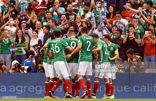 Players of Mexico celebrates after teammate Jesus Corona scored against Canada during their Russia 2018 FIFA World Cup Concacaf Qualifiers' football...