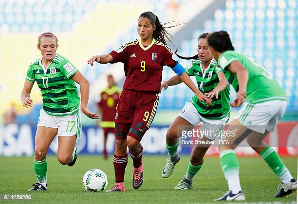 Players of Mexico challenge Deyna Castellanos of Venezuela during the FIFA U17 Women's World Cup Quarter Final match between Mexico and Venezuela at...