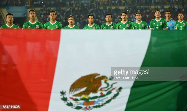 Players of Mexico sing their national anthem during the FIFA U17 World Cup India 2017 group E match between Mexico and Chile at Indira Gandhi...