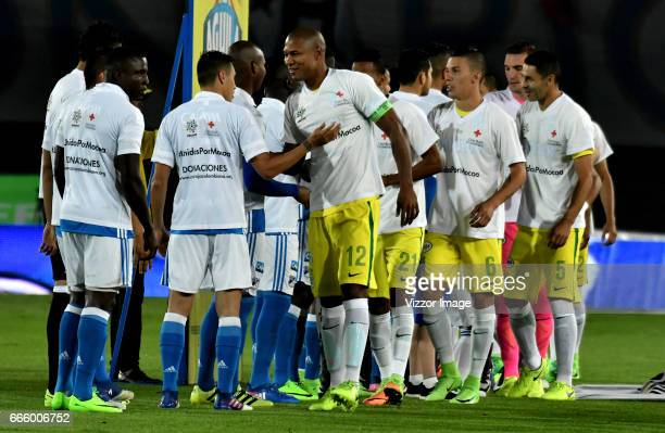 Players of Millonarios and Atletico Nacional shake hands prior the match between Millonarios and Atletico Nacional as part of the Liga Aguila I 2017...