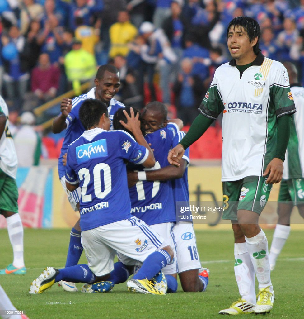 Players of Millonarios celebrate a goal against Equidad during a match between Millonarios and Equidad as part of the Liga Postobon 2013 at Nemesio Camacho Stadium on February 03, 2013 in Bogota, Colombia.