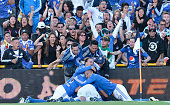 Players of Millonarios celebrate after scoring during a second leg match between Millonarios and Junior as part of quarter finals of Liga Aguila I...