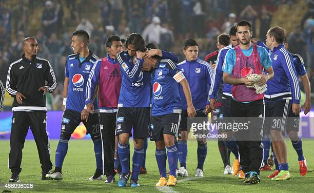 Players of Millonarios celebrate their victory against Boyaca Chico FC after a match between Millonarios and Boyaca Chico as part of 12th round of...