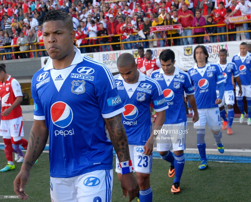 Players of Millonarios enter the field before a match between Independiente Santa Fe and Millonarios as part of the Liga Postobon II at Nemesio Camacho Stadium on September 21, 2013 in Bogota, Colombia.