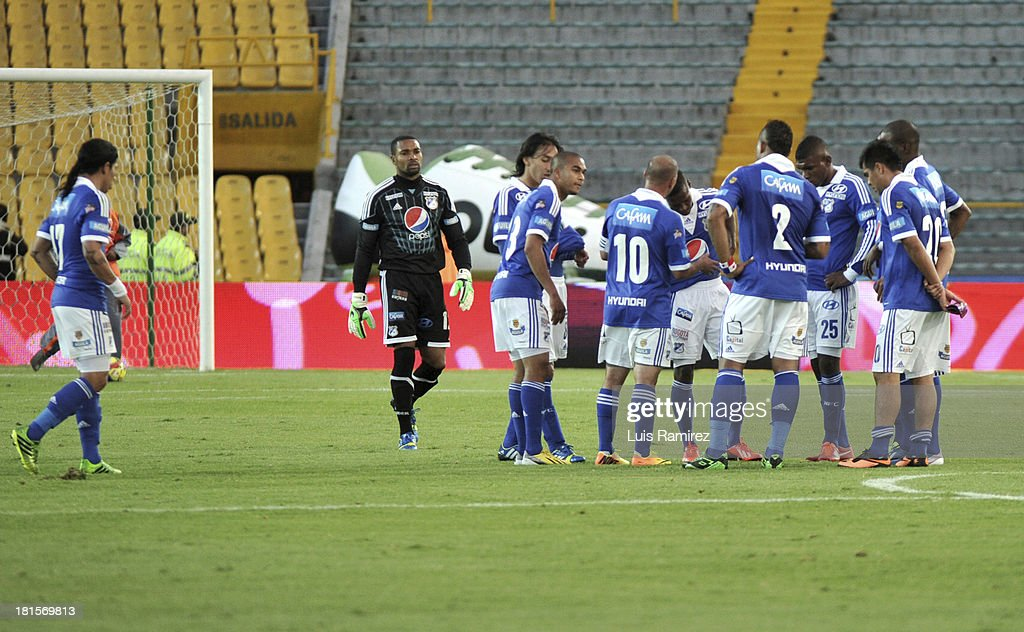 Players of Millonarios gather after a match between Independiente Santa Fe and Millonarios as part of the Liga Postobon II at Nemesio Camacho Stadium on September 21, 2013 in Bogota, Colombia.