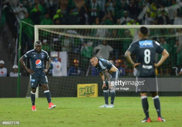 Players of Millonarios look dejected after the semi finals second leg match between Atletico Nacional and Millonarios as part of the of the Liga...