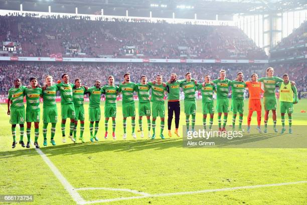 Players of Moenchengladbach celebrate after the Bundesliga match between 1 FC Koeln and Borussia Moenchengladbach at RheinEnergieStadion on April 8...