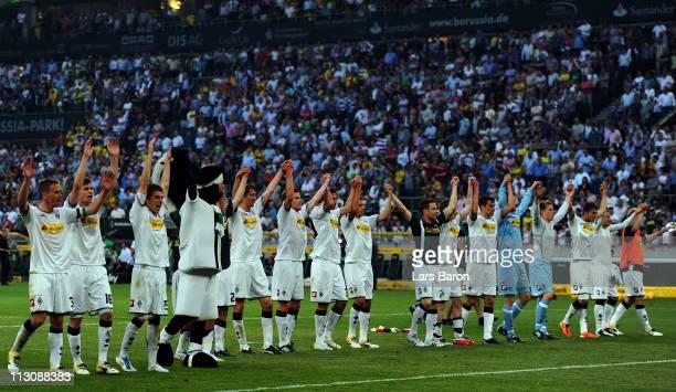 Players of Moenchengladbach celebrate after winning the Bundesliga match between Borussia Moenchengladbach and Borussia Dortmund at Borussia Park...