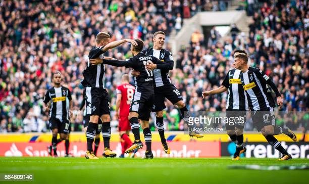 Players of Moenchengladbach celebrate their teams first goal during the Bundesliga match between Borussia Moenchengladbach and Bayer 04 Leverkusen at...