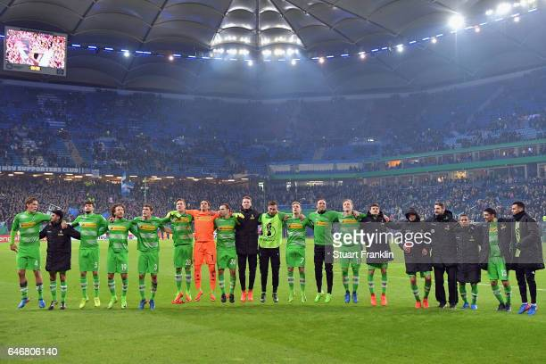 Players of Moenchengladbach celebrate with the fans after the DFB Cup quarter final between Hamburger SV and Borussia Moenchengladbach at...