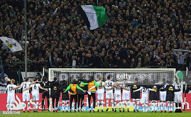 Players of Moenchengladbach celebrate with the fans after the Bundesliga match between Borussia Moenchengladbach and FC Bayern Muenchen at...