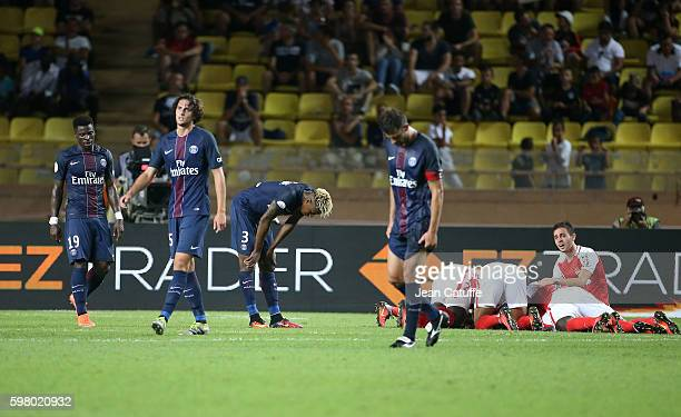 Players of Monaco celebrate their third goal while Serge Aurier Adrien Rabiot Presnel Kimpembe Thiago Motta of PSG look down during the French Ligue...