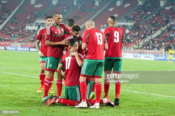 Players of Morocco celebrate their victory after the 2017 African Cup of Nations qualification football match between the national teams of Morocco...