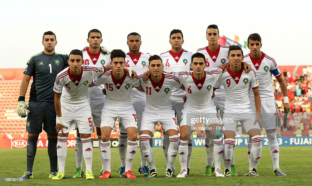 Players of Morocco line up for a group photograph during the Round of 16 match of the FIFA U-17 World Cup between Morocco and Ivory Coast at Fujairah Stadium on October 29, 2013 in Fujairah, United Arab Emirates.