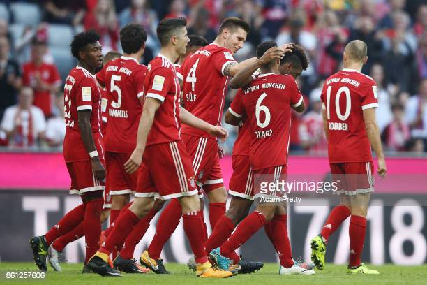 Players of Muenchen celebrate after Joshua Kimmich of Bayern Muenchen scored his teams fifth goal to make it 50 during the Bundesliga match between...