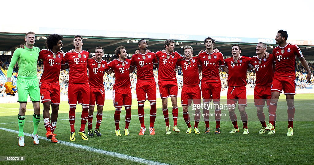 Players of Muenchen celebrate after the Bundesliga match between Eintracht Braunschweig and FC Bayern Muenchen at Eintracht Stadion on April 19, 2014 in Braunschweig, Germany.