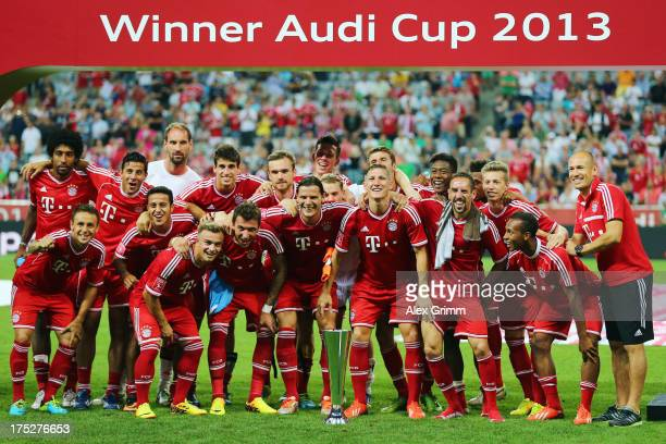 Players of Muenchen celebrate after winning the Audi Cup Final match against Manchester City at Allianz Arena on August 1 2013 in Munich Germany