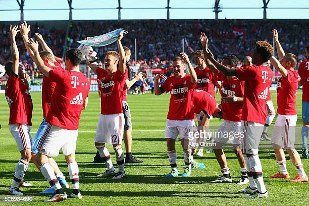 Players of Muenchen celebrate being Bundesliga champions after beating Ingolstadt 21 in the Bundesliga match between FC Ingolstadt and FC Bayern...
