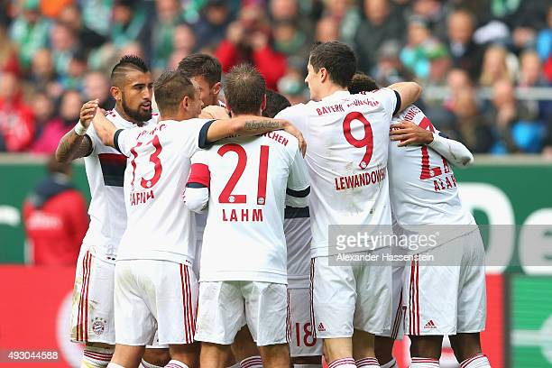 Players of Muenchen celebrate the opening goal during the Bundesliga match between SV Werder Bremen and FC Bayern Muenchen at Weserstadion on October...