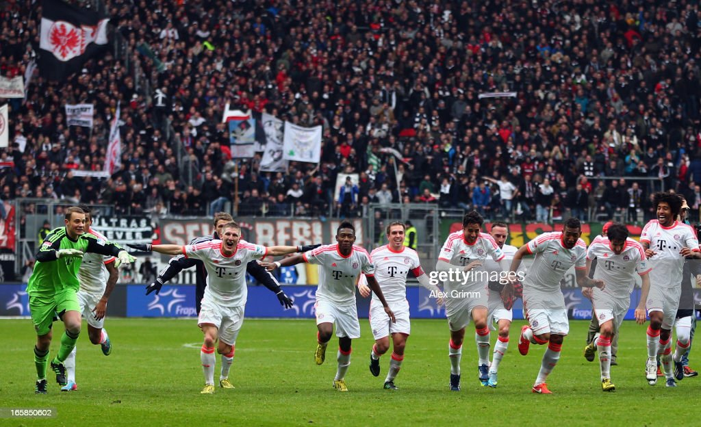 Players of Muenchen celebrate winning the Bundesliga after the match between Eintracht Frankfurt and FC Bayern Muenchen at CommerzbankArena on April...