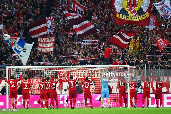 Players of Muenchen celebrate with the fans after the Bundesliga match between FC Bayern Muenchen and Borussia Dortmund at Allianz Arena on October 4...