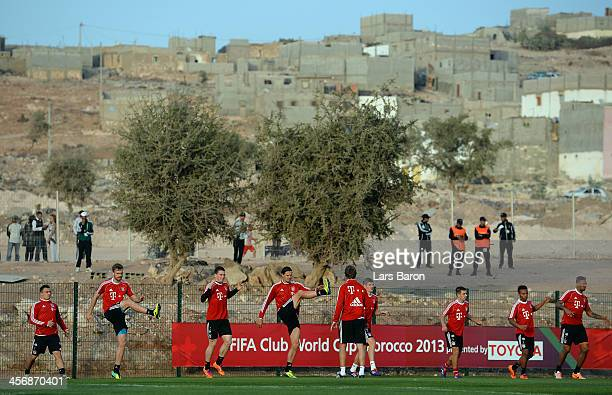 Players of Muenchen warm up during a Bayern Muenchen training session for the FIFA Club World Cup outside at Agadir Stadium on December 15 2013 in...