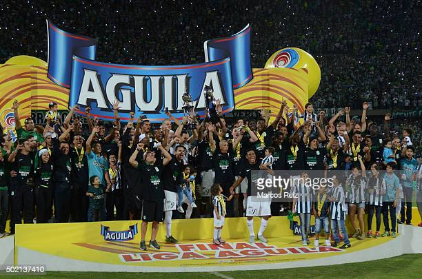 Players of Nacional celebrate after winning a second leg final match between Atletico Nacional and Atletico Junior as part of Liga Aguila II 2015 at...