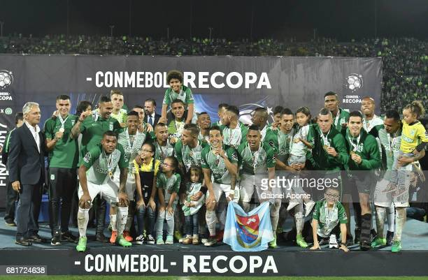 Players of Nacional pose for a group photo after winning a match between Atletico Nacional and Chapecoense as part of CONMEBOL Recopa Sudamericana...