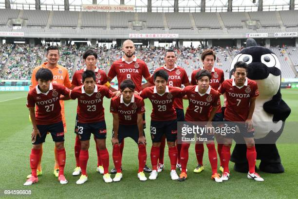 Players of Nagoya Grampus line up for the team photos prior to the JLeague J2 match between Tokyo Verdy and Nagoya Grampus at Ajinomoto Stadium on...