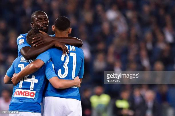Players of Napoli celebrate after Lorenzo Insigne of Napoli scored first goal during the Serie A match between Roma and Napoli at Olympic Stadium...