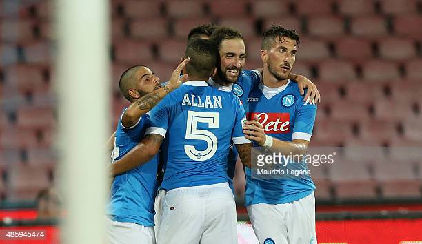 Players of Napoli celebrate the second goal during the Serie A match between SSC Napoli and UC Sampdoria at Stadio San Paolo on August 30 2015 in...