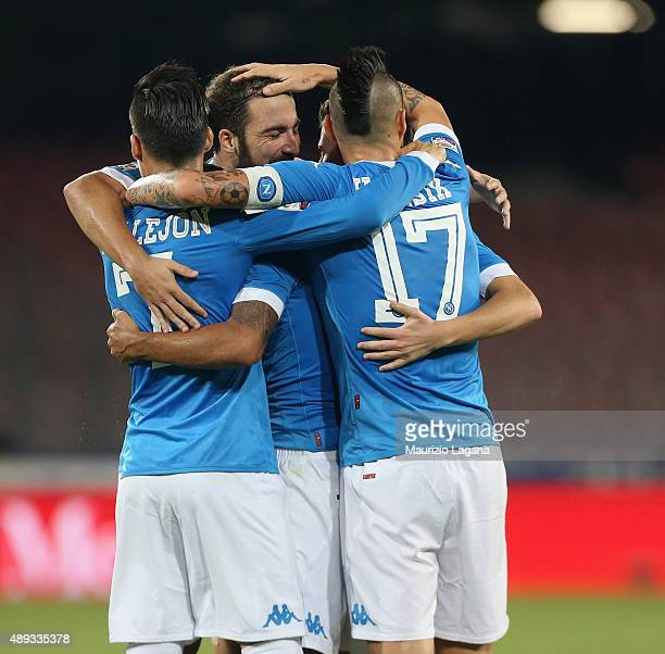 Players of Napoli celebrate the second goal during the Serie A match between SSC Napoli and SS Lazio at Stadio San Paolo on September 20 2015 in...