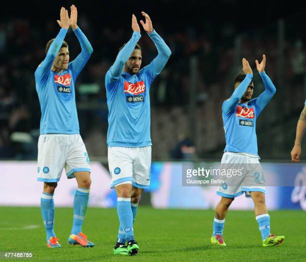 Players of Napoli celebrate the victory after the Serie A match between SSC Napoli and AS Roma at Stadio San Paolo on March 9 2014 in Naples Italy