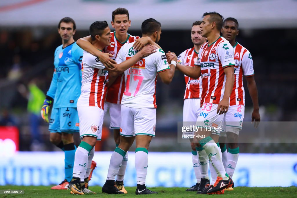 Players of Necaxa celebrate after winning the 14th round match between America and Necaxa as part of the Torneo Apertura 2017 Liga MX at Azteca Stadium on October 21, 2017 in Mexico City, Mexico.