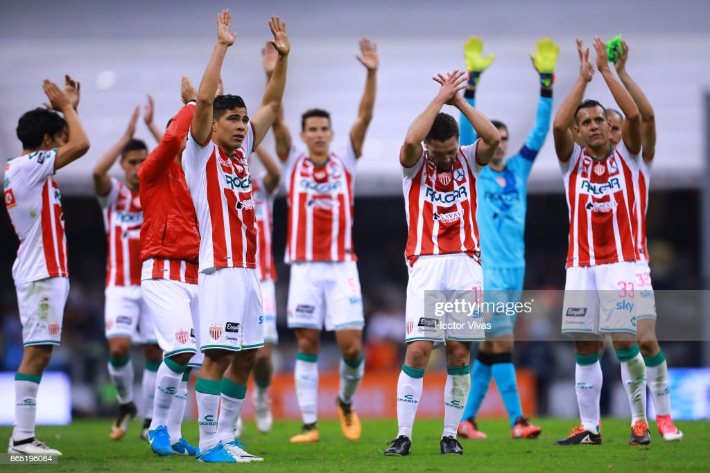 Players of Necaxa celebrate their victory after the 14th round match between America and Necaxa as part of the Torneo Apertura 2017 Liga MX at Azteca Stadium on October 21, 2017 in Mexico City, Mexico.