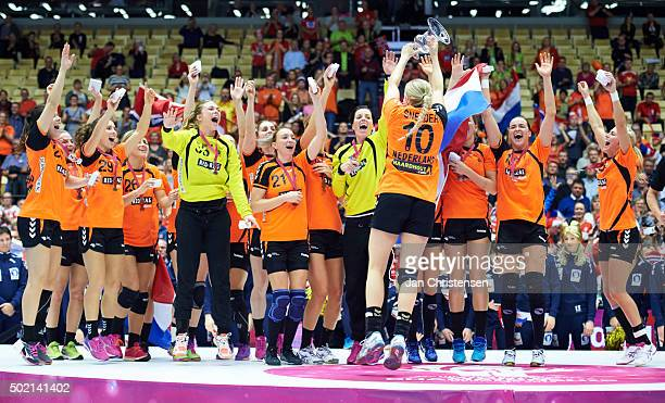Players of Netherlands celebrate silver during medal ceremony after the 22nd IHF Women's Handball World Championship Gold Medal match between...
