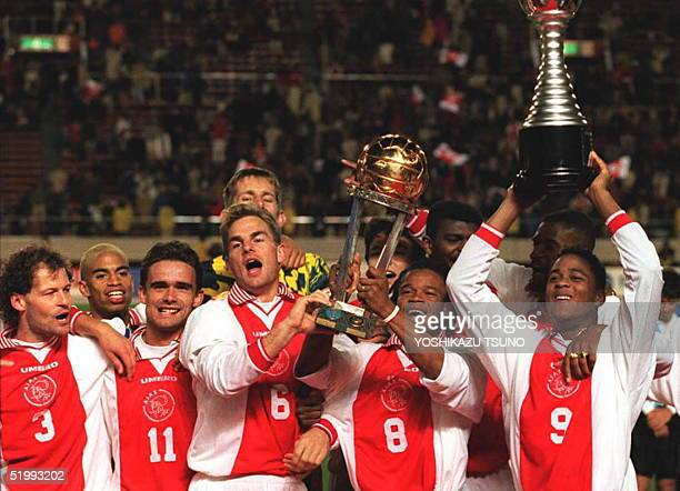 Players of Netherlands football club Ajax LR Danny Blind Marc Overmars Ronald de Boer Edger Davids and Patrick Kluivert sing in jubilation while...